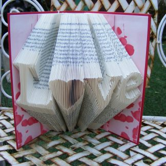 Folded book art. Words folded into pages of books.